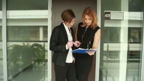Two businesswomen discussing a contract. go around the office stock video