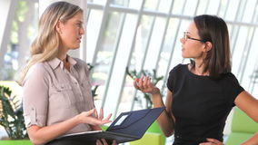 Two Businesswomen Discussing Document In Office stock video footage