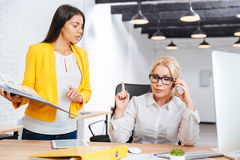 Two businesswomen discussing ideas at the table in the office Stock Images