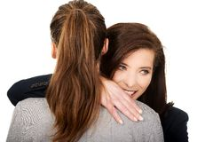Two businesswomen embracing each other. Stock Photo