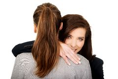 Two businesswomen embracing each other. Stock Image