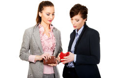 Two businesswomen with empty wallets. Royalty Free Stock Images
