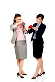 Two businesswomen with empty wallets. Royalty Free Stock Photography