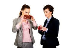 Two businesswomen with empty wallets. Stock Photo