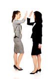 Two businesswomen giving a high five. Stock Photo