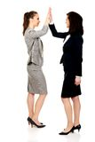Two businesswomen giving a high five. Royalty Free Stock Photo