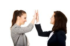 Two businesswomen giving a high five. Stock Image