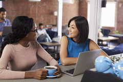 Two Businesswomen Have Informal Meeting In Office Coffee Bar Stock Photo