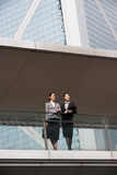 Two Businesswomen Having Discussion. Outside Office Building Stock Image