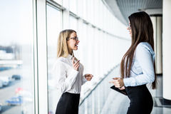 Two Businesswomen Having Informal Meeting In Modern Office Royalty Free Stock Photography