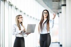 Two Businesswomen Having Informal Meeting In Modern Office stock photography