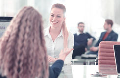 Two Businesswomen Having Informal Meeting In Modern Office. Image of two friendly businesswomen sitting and discussing new ideas Stock Photography