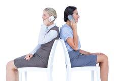 Two businesswomen having phone call Stock Images