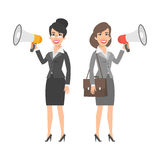 Two businesswomen holding speakers and smiling Royalty Free Stock Photos