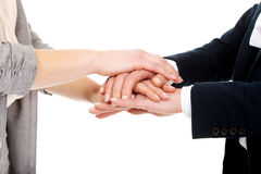 Two businesswomen holding their hands together. Royalty Free Stock Photography