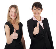 Two businesswomen holding thumbs up Royalty Free Stock Image