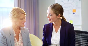 Two businesswomen interacting with each other. In office 4k stock video