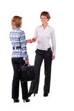 Two businesswomen introduce themselves Stock Images