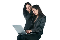 Two businesswomen with laptop Royalty Free Stock Photos
