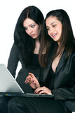 Two businesswomen with laptop Stock Photography