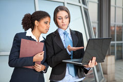 Two businesswomen looking in laptop Royalty Free Stock Photo