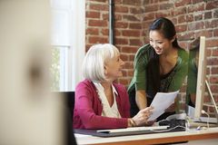 Two Businesswomen Meeting In Creative Office Royalty Free Stock Photography