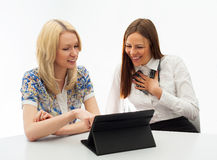 Two Businesswomen Meeting In Office. With tablet pc. Isolated Stock Image
