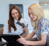 Two Businesswomen Meeting In Office with tablet pc. Smiling Stock Photography