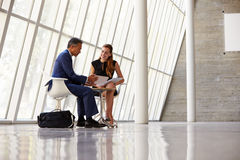 Two Businesswomen Meeting In Reception Of Modern Office Stock Photography