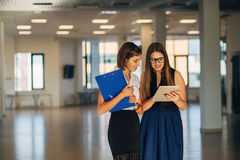 Two businesswomen in the office discussing business plan Stock Image
