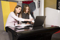 Two businesswomen at office working with laptop Stock Photos