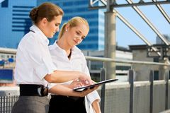 Two businesswomen with paper chart Royalty Free Stock Image