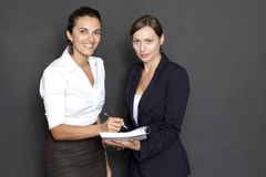 Two businesswomen with paper work Royalty Free Stock Photo