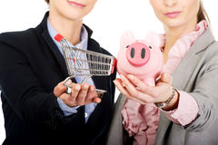 Two businesswomen with piggy bank. Stock Photo