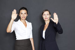 Two businesswomen pointing on a virtual screen Stock Photo
