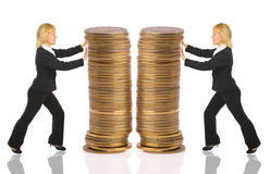 Two businesswomen push rouleau money Royalty Free Stock Photo