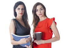 Two businesswomen. With serious expression Stock Photos