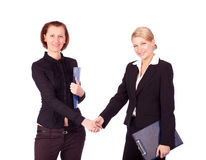 Two businesswomen shaking hands Stock Photos