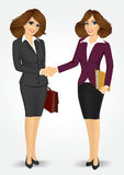 Two businesswomen shaking hands Royalty Free Stock Photos