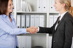 Two Businesswomen Shaking Hands Stock Images