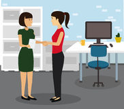 Two Businesswomen Shaking Hands In Modern Office. Stock Image