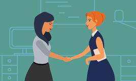 Two Businesswomen Shaking Hands In Modern Office. Royalty Free Stock Images