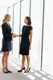 Two Businesswomen Shaking Hands Royalty Free Stock Image