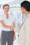 Two businesswomen shaking hands Stock Photography