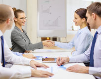 Two businesswomen shaking hands in office Royalty Free Stock Photos