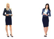 Two businesswomen showing an empty Royalty Free Stock Images