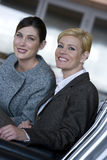 Two businesswomen smiling and posing Royalty Free Stock Photography