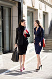 Two businesswomen. Standing on the building background and look at each other Stock Images