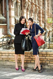 Two businesswomen. Standing on the building background and look at each other Royalty Free Stock Photos