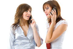 Two businesswomen talking by phone Royalty Free Stock Photography